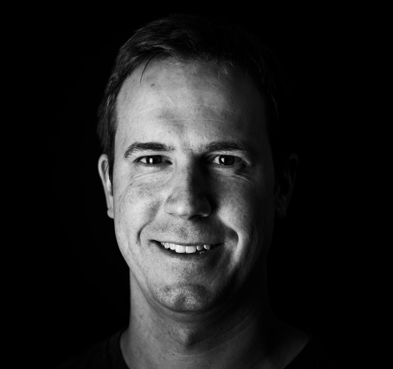 Headshot of Tom Feldman, founder and CTO of STOKE