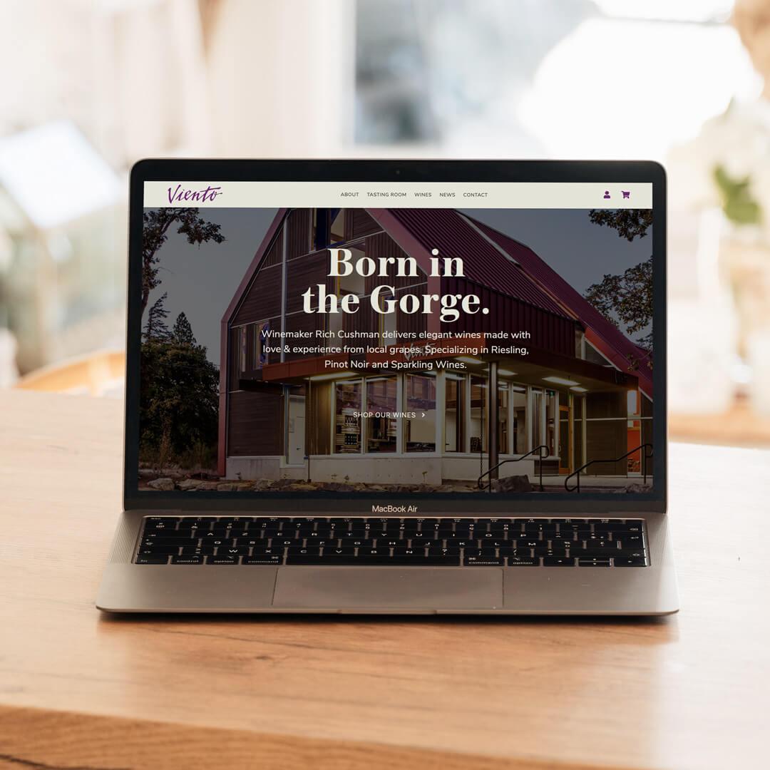 Viento Wines website design homepage mockup on a laptop