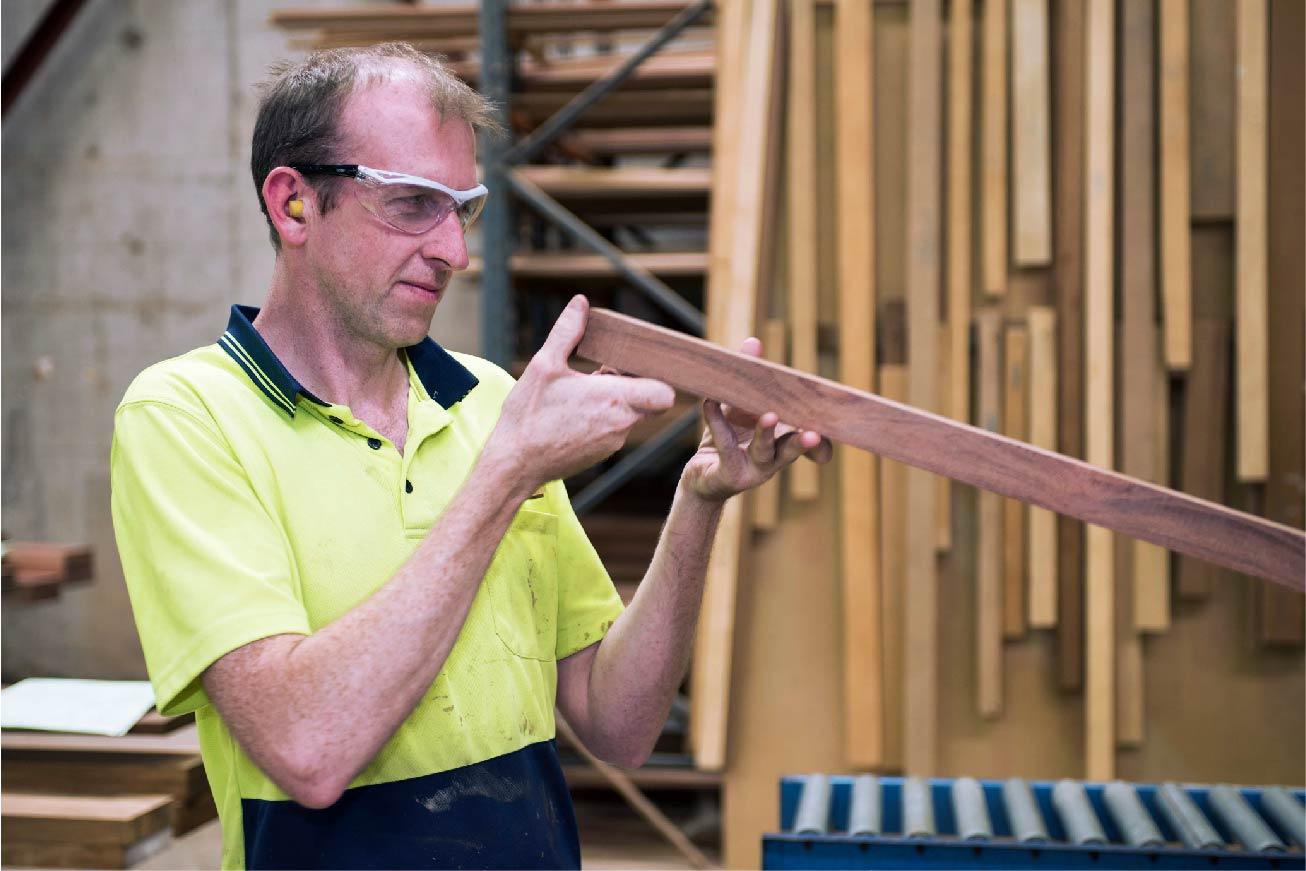 Man looking at timber