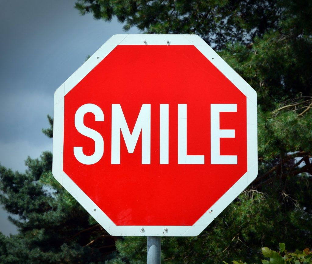Smile, when you are welcoming/greeting your guests