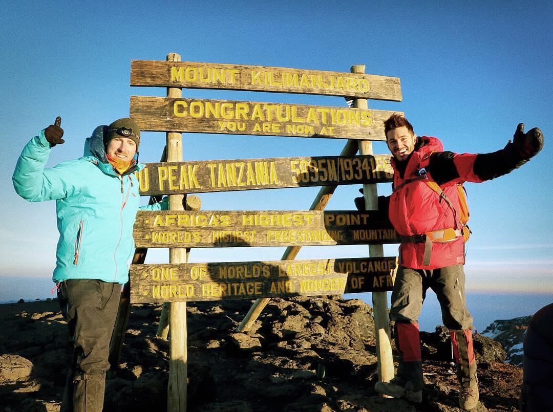 Jonathan hiking Mt. Kilamanjaro.