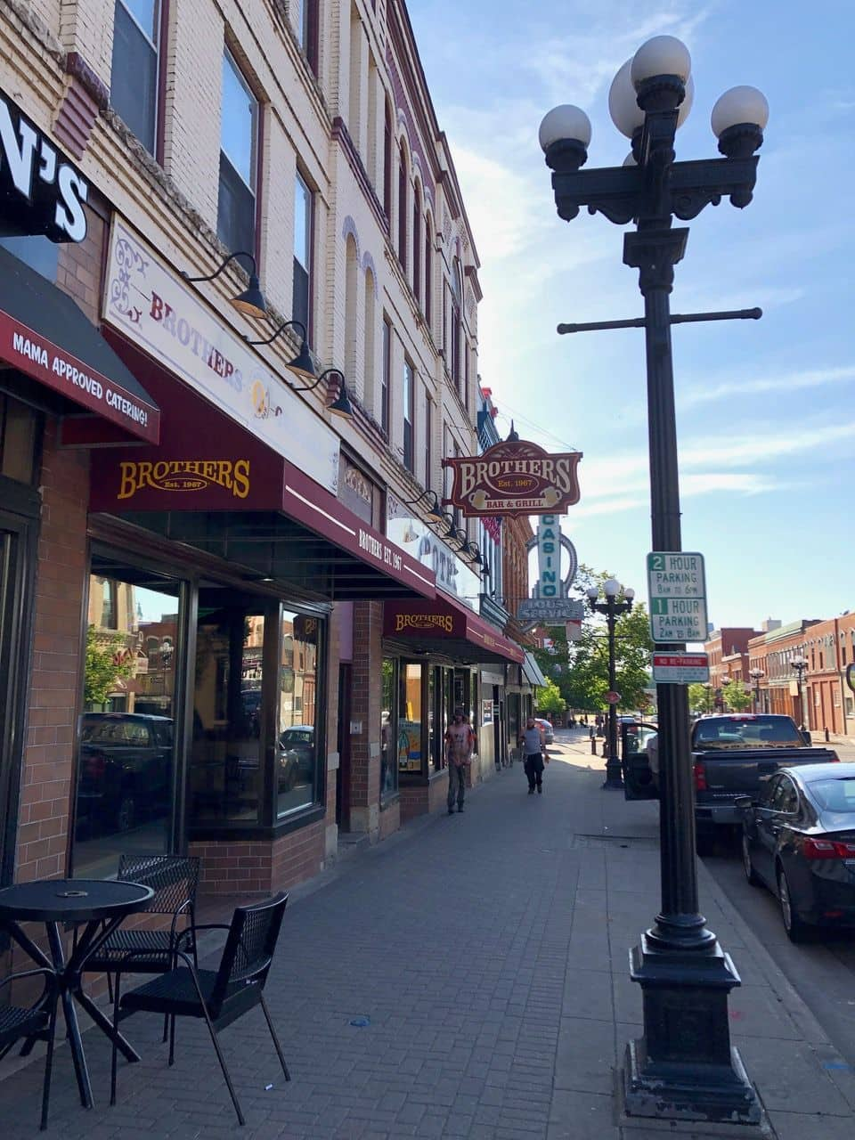 A wide shot of series of storefronts with restaurants and other businesses.
