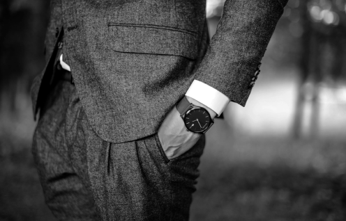 Close Up Photo of Person in Business Suit, Watch.