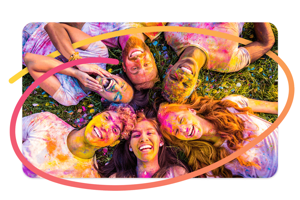 Pixtd Moment: A group of friends covered in colourful powder at an outdoor event