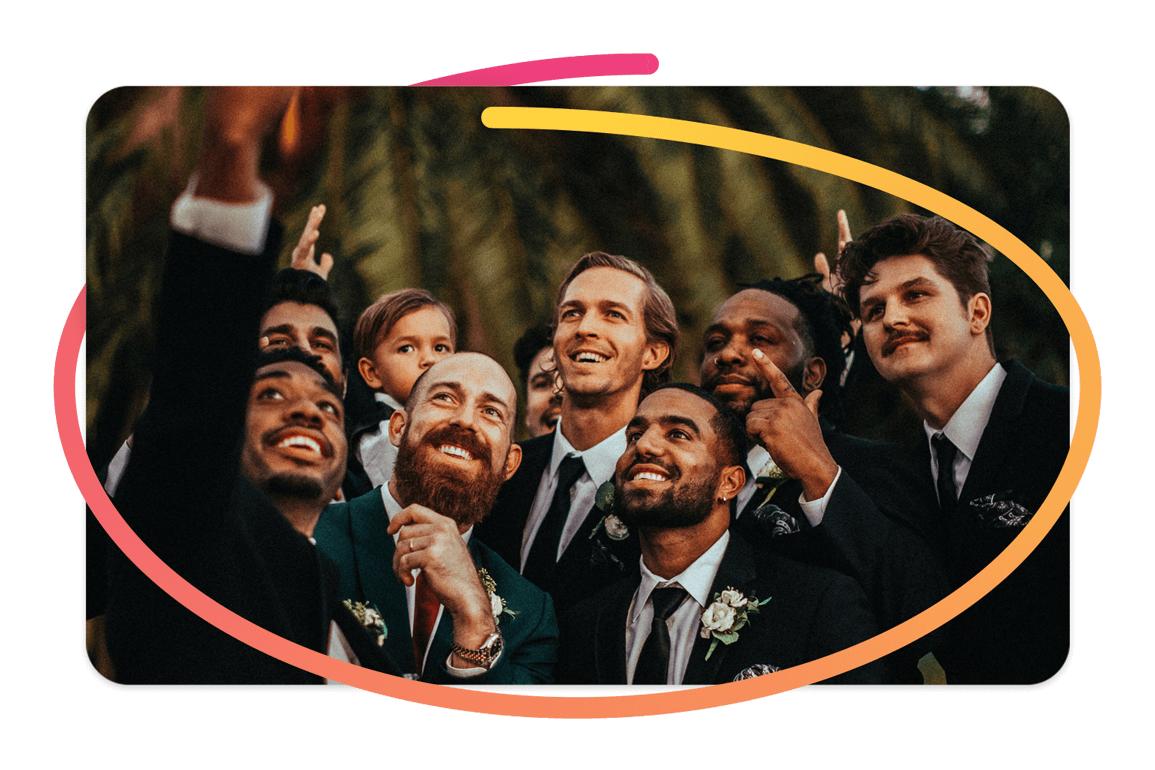 Pixtd Moment: A group of groomsmen having fun at an outdoor wedding