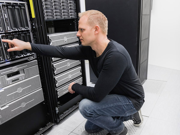 Image of an engineer working on a server rack