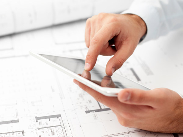 Image of an architect's hands holding an iPad