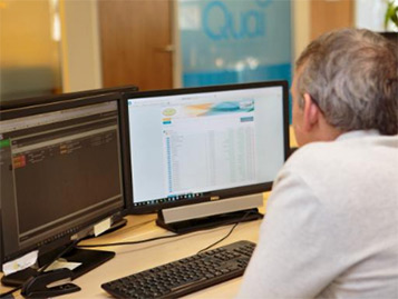 Quai Admin staff working on a workstation