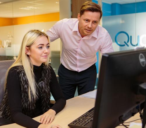 Quai admin staff working on a computer