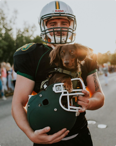 player with dog UVM