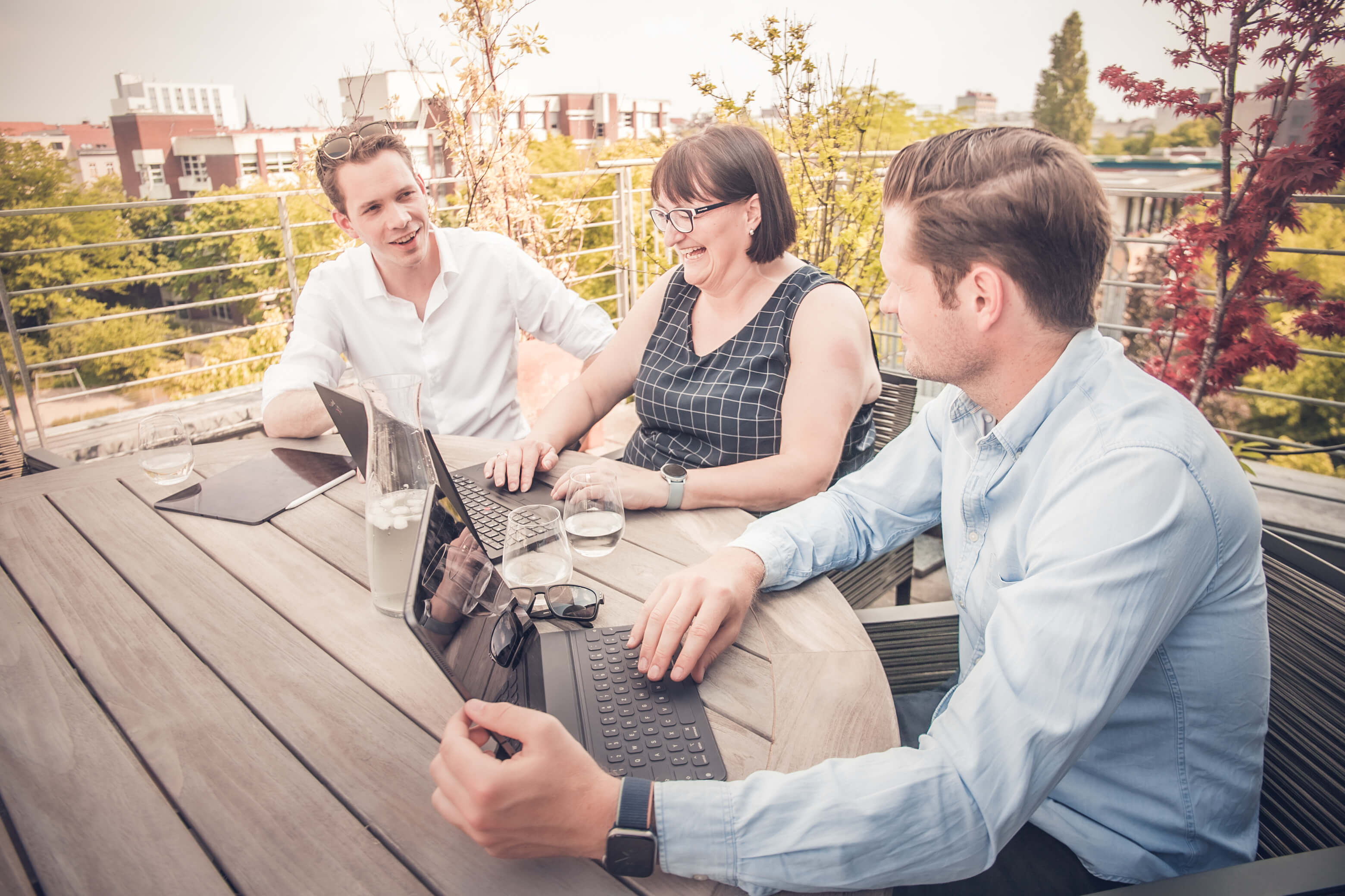 The Orbit team working together on a terrace