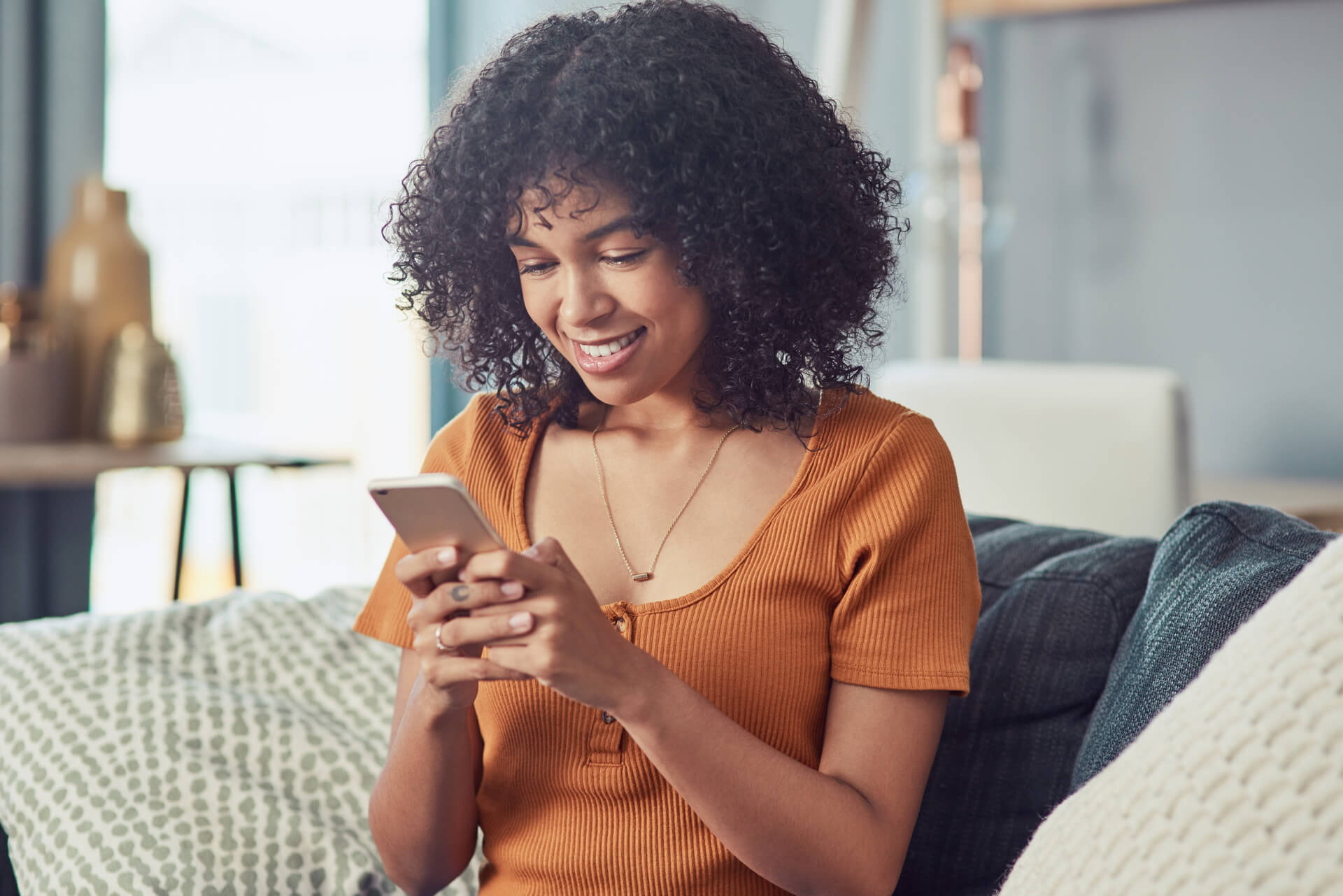 A picture of a women on her phone