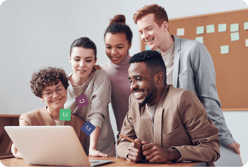 Employees smiling and looking at computer
