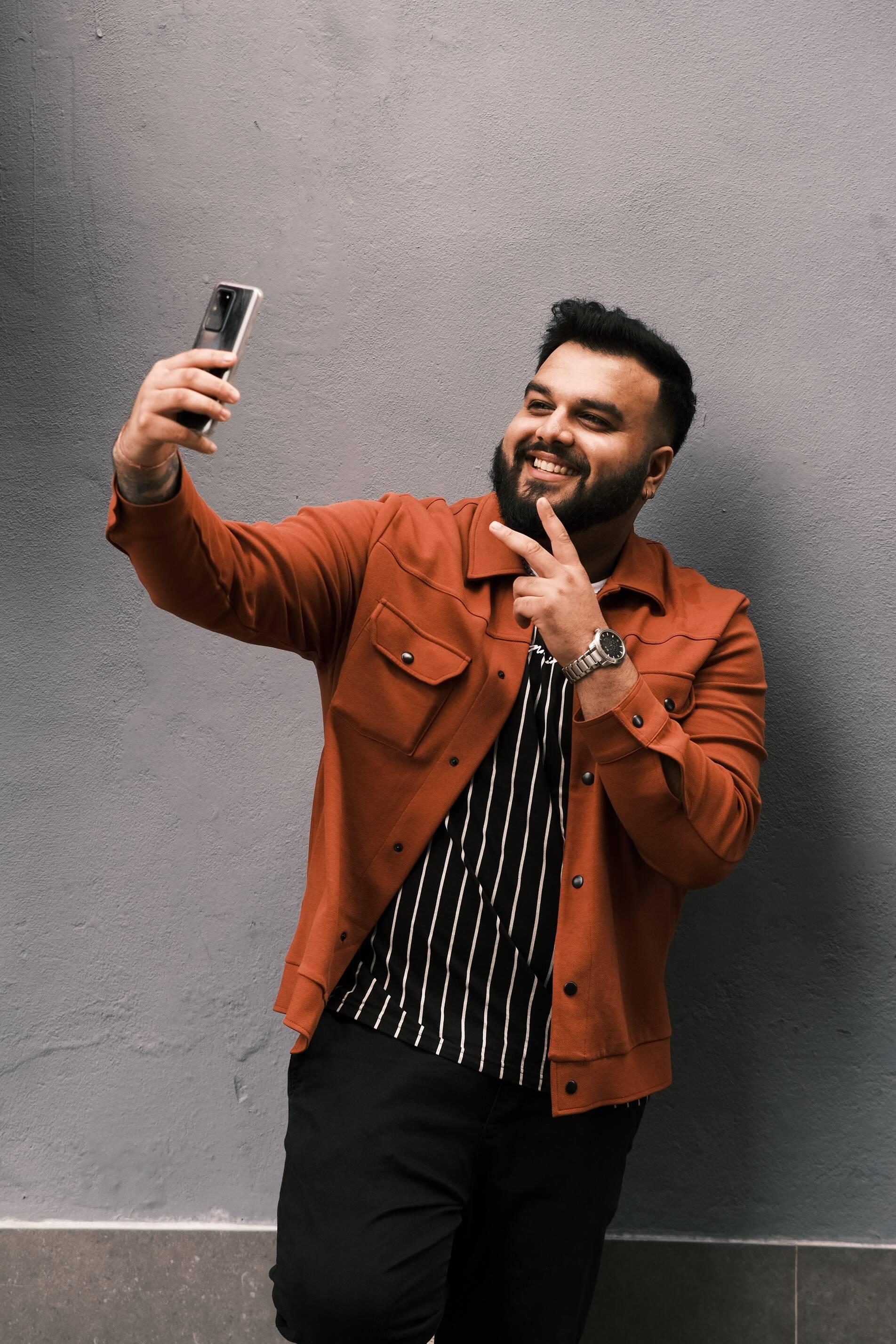 man-doing-a-selfie-video