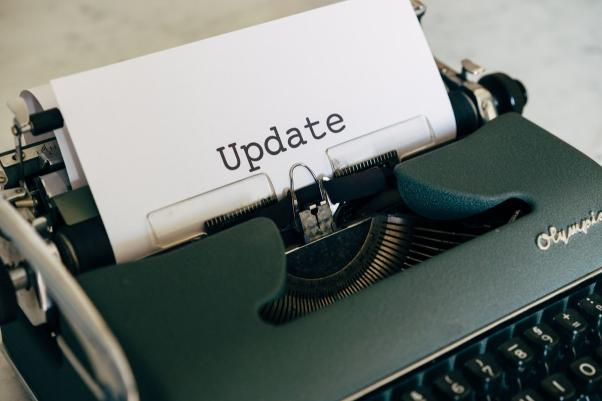 """A typewriter with the word """"Update"""" on it."""