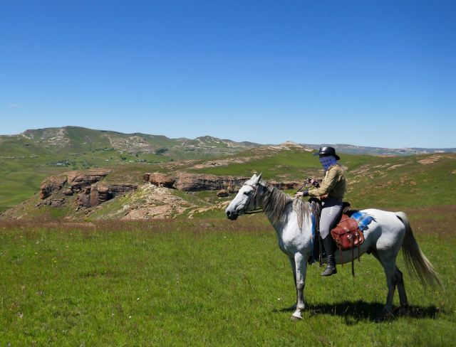 Horse riding in the open field of sehlabathebe national park lesotho