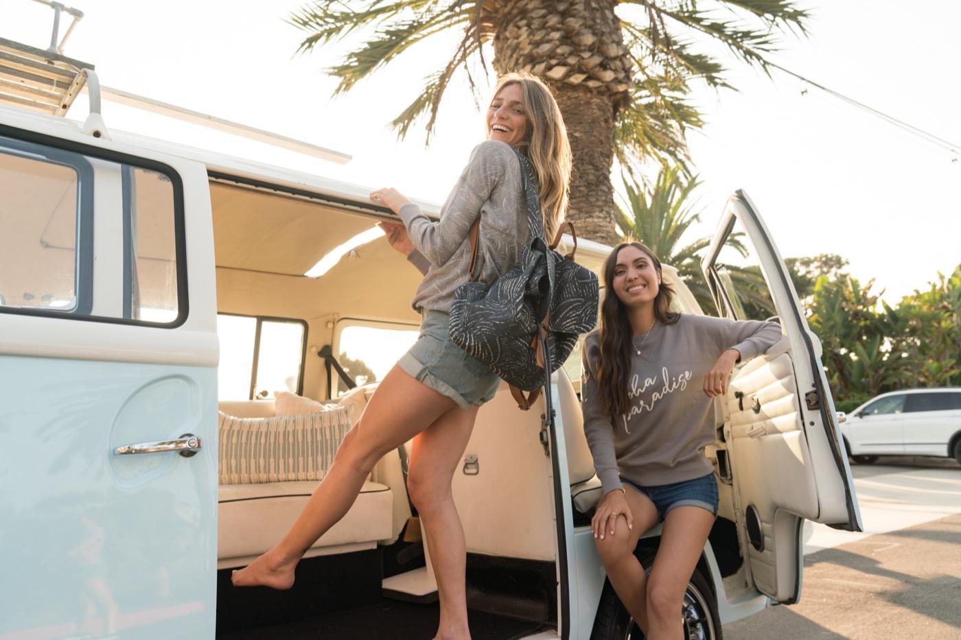 Beachly brand models on a van