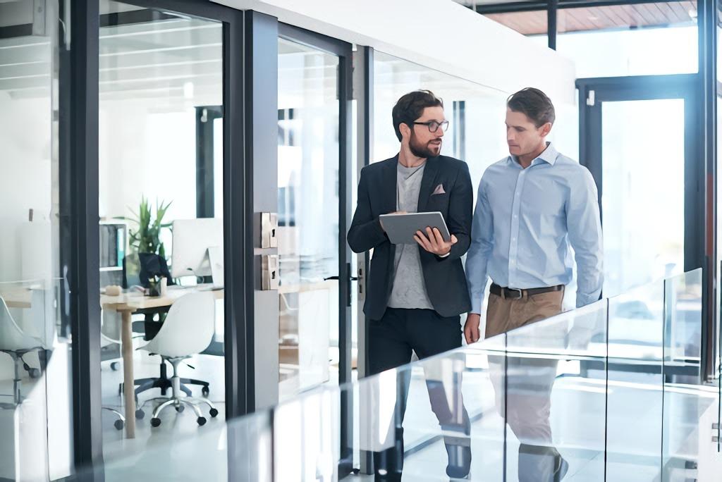 men talking at the office