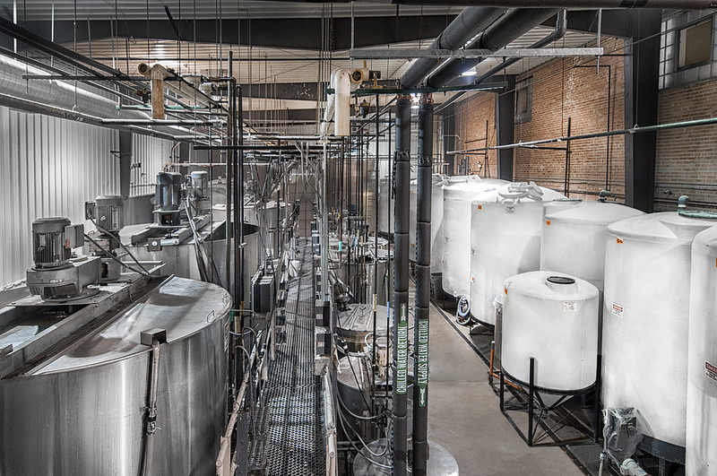 RNA batch cooking kettles and plastic storage tanks.