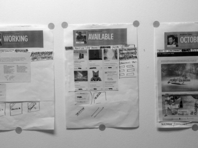 Paper prototype's of a job listing pasted on a whiteboard