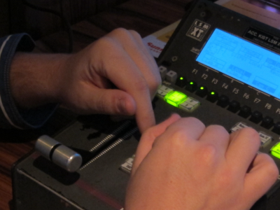 The hands of a  slow-motion operator during a football game