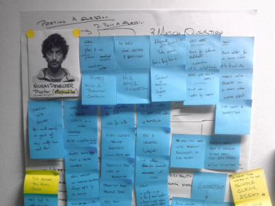 Post-it notes from a user interview pasted on the wall