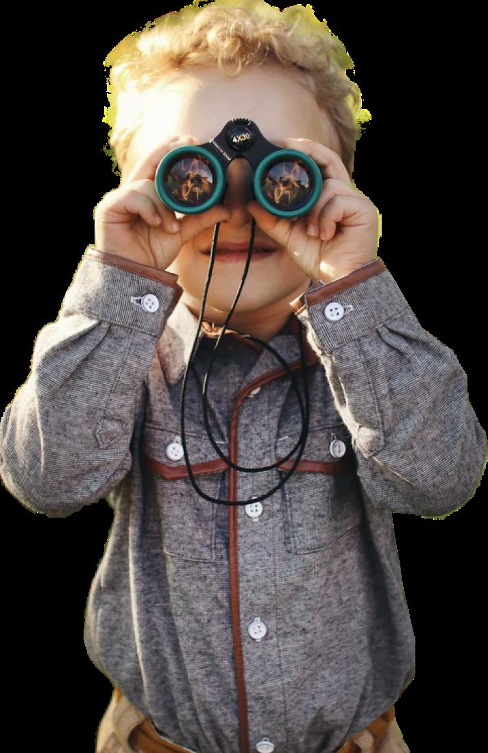 Photo of a little kid with binoculars