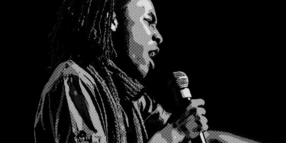 A young man sings into a microphone