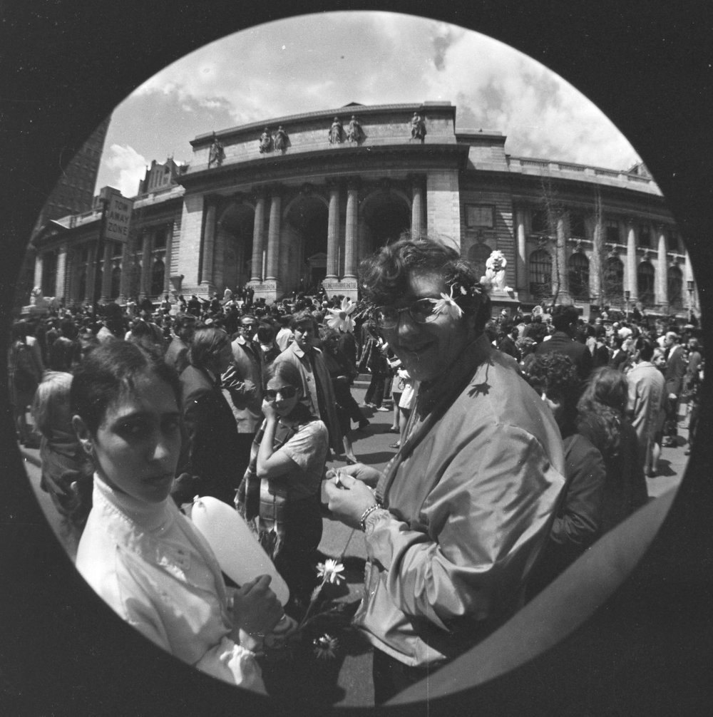 Fisheye photo showing New York Public Library during Earth Day, April 22, 1970  The first Earth Day included demonstrations demanding city and national protections for the environment.Mayor John V. Lindsay spoke from the steps of the New York Public Library and in Union Square about the need to reduce pollution and enact policies that would improve the quality of life.