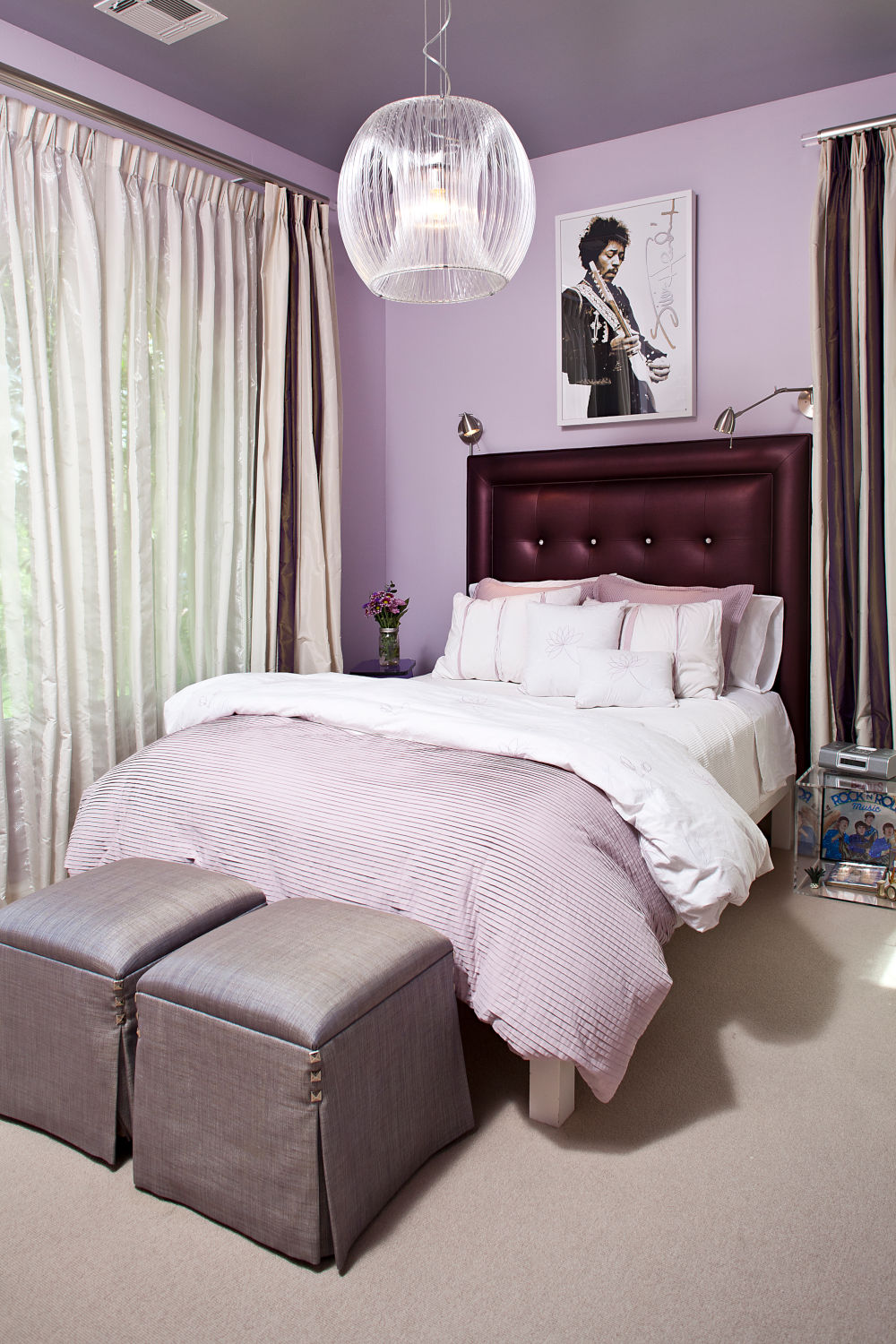 Mauve girls bedroom with purple headboard and Prince poster.