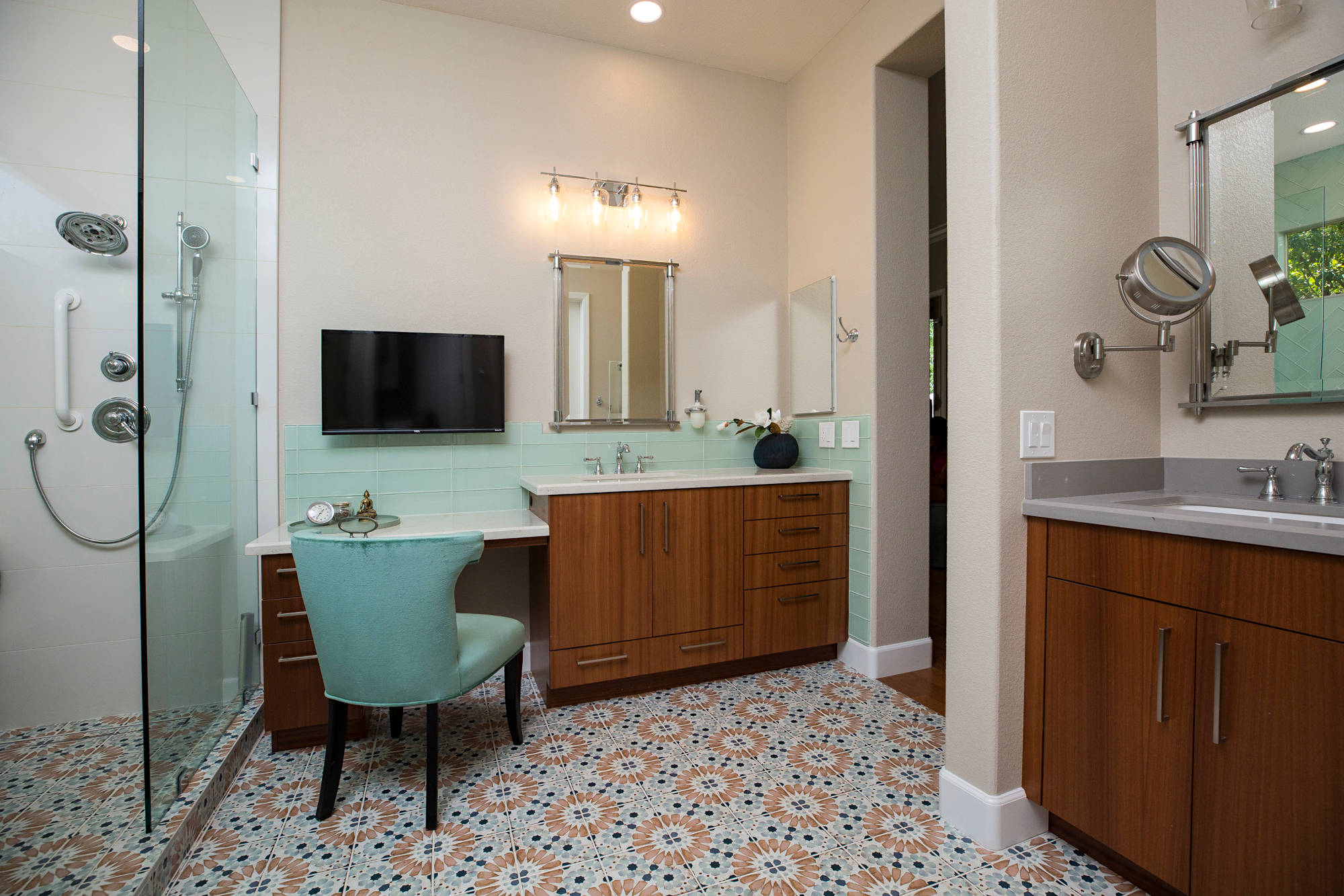 Spa inspired master bath with multi colored floor tile and large walk-in shower.