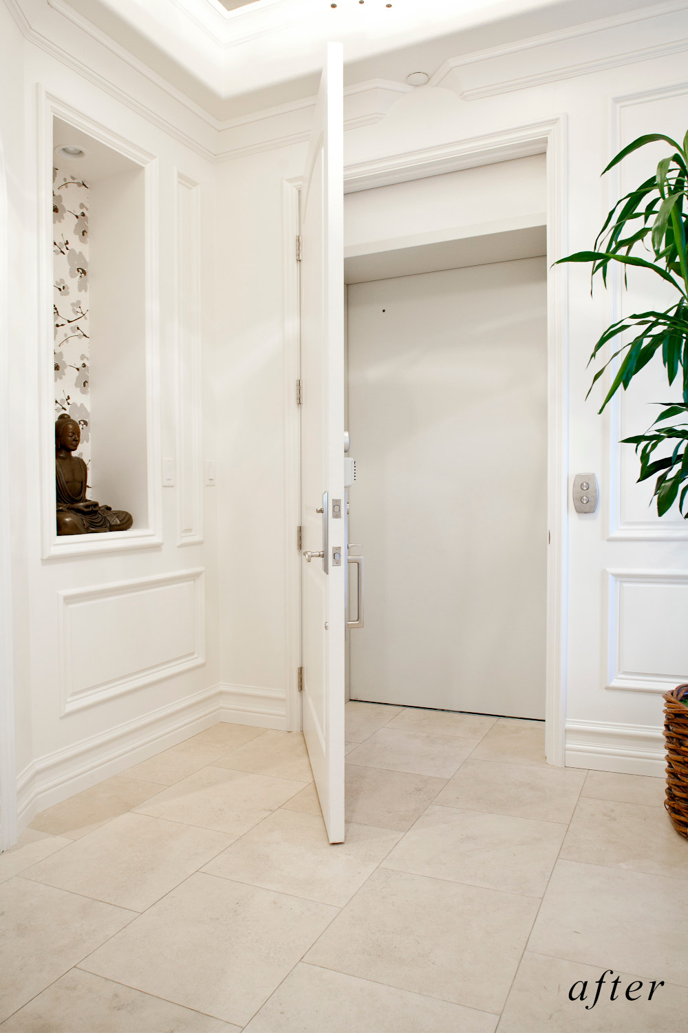 After remodel image: home elevator door with white wood molding, white wood paneling surround.