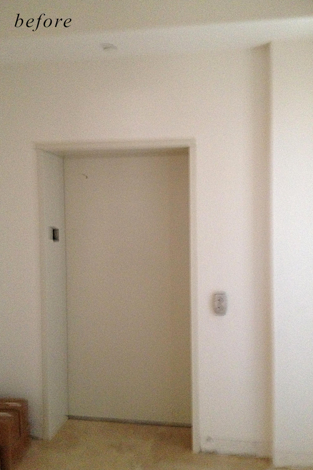 Before remodel  image: dull and basic home elevator doors.