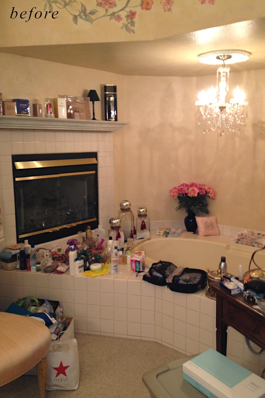 Before remodel image: old and basic white tiled master bathroom.