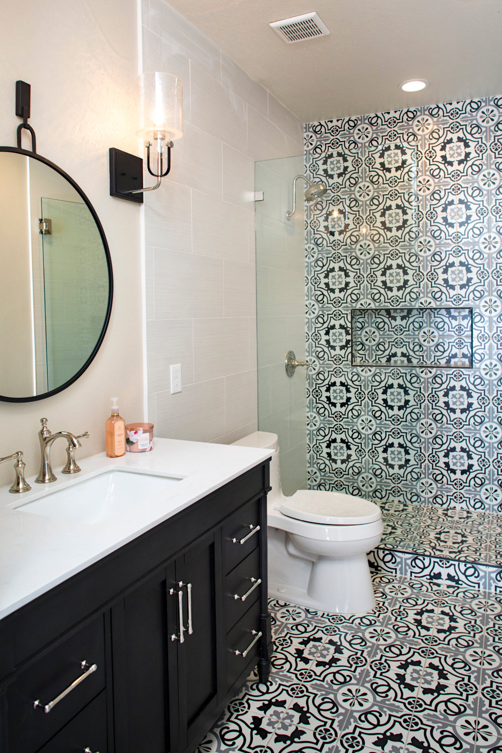 Updated bathroom and walk-in shower to white and black themed marble and tile.