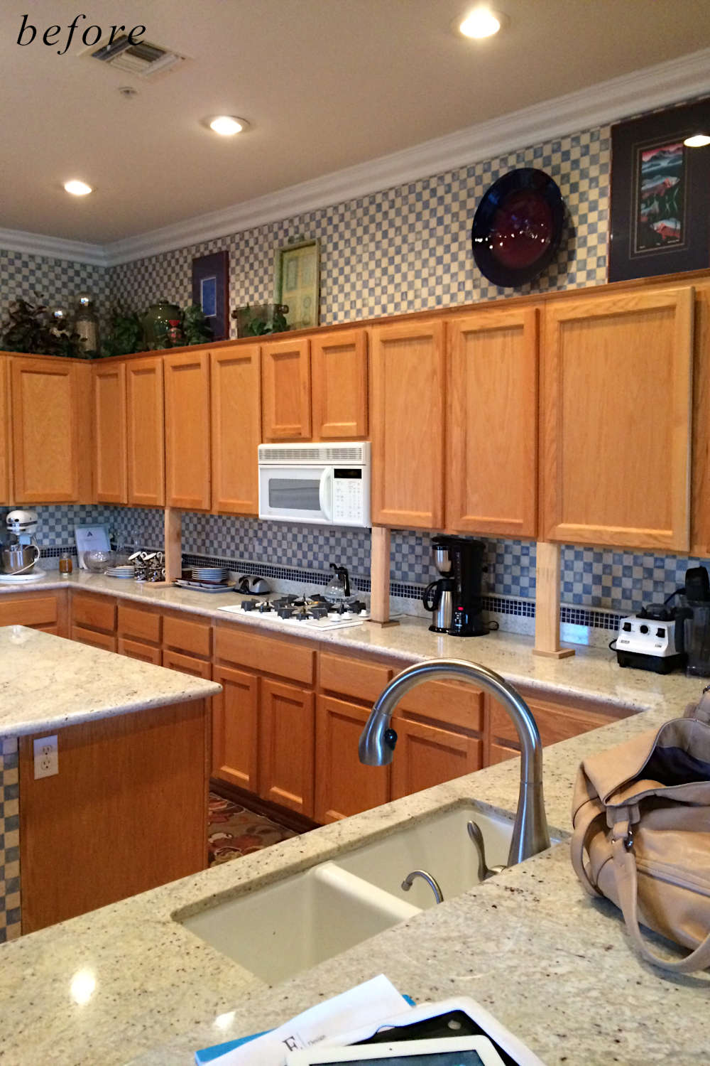 Before remodel image: falling apart old kitchen with basic brown cabinets.