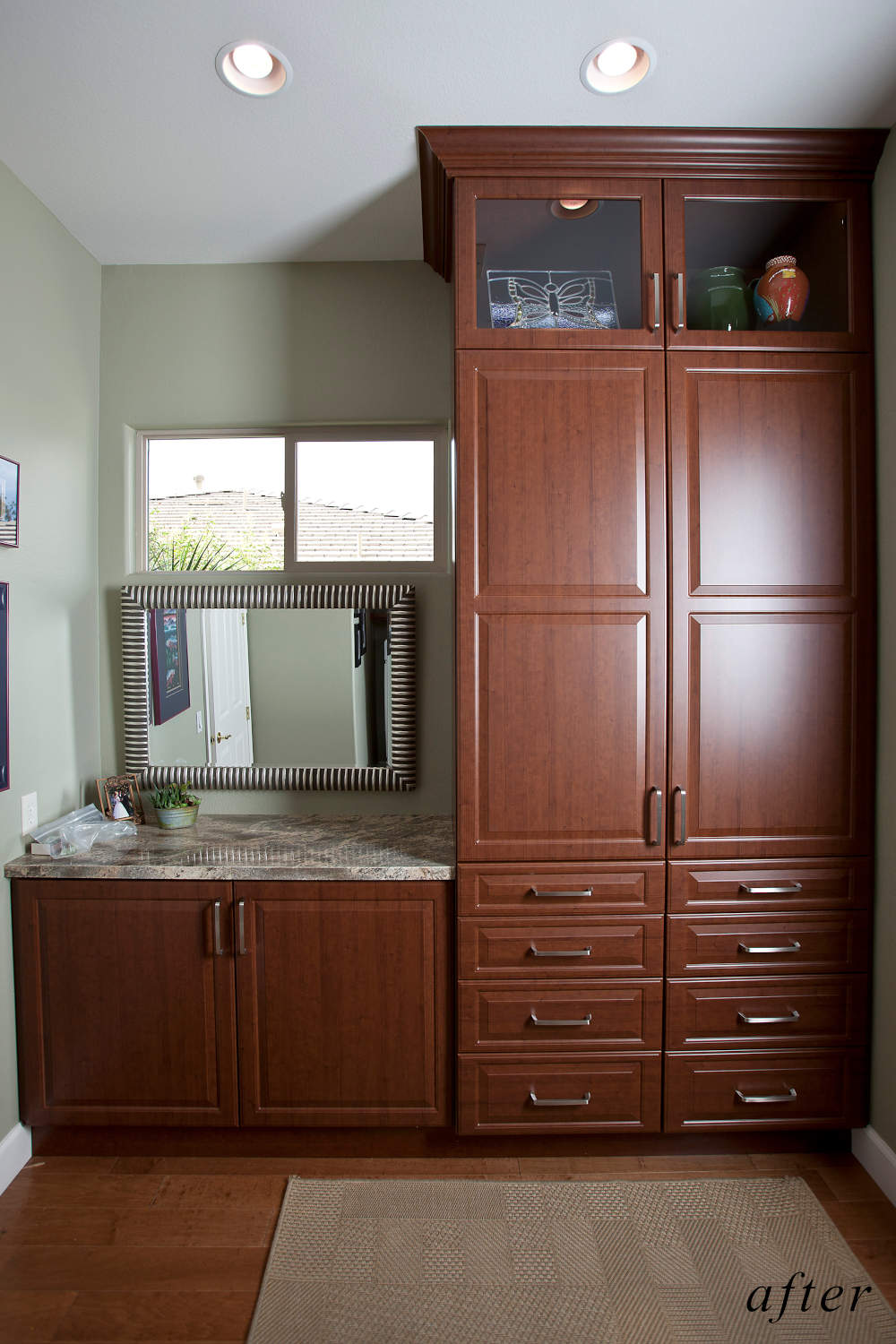 After remodel image: New laundry room with floor to ceiling cherry wood cabinets, granite counters.
