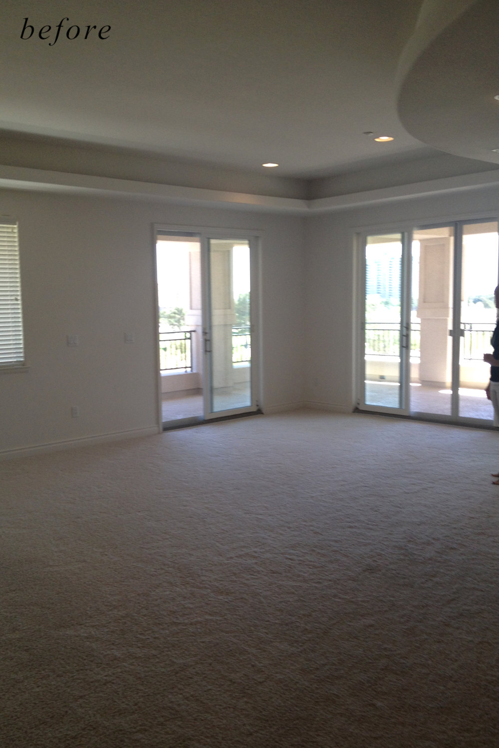 Before remodel image: basic and dull home dining room area with no furniture.