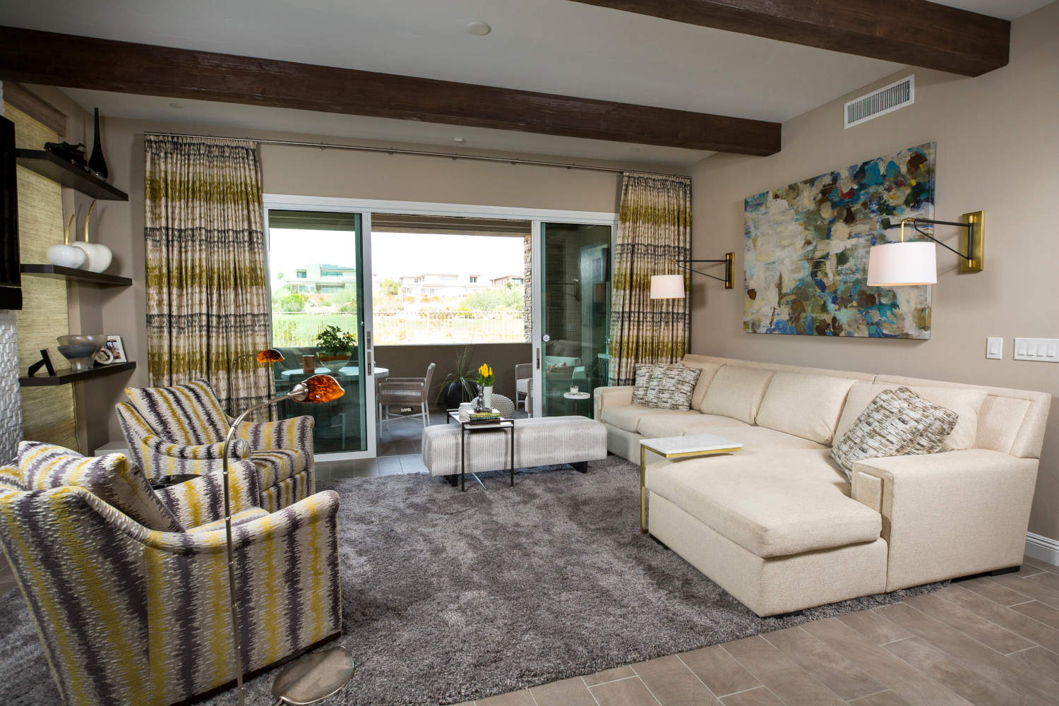 Family room with two yellow and black chairs and cream sectional.