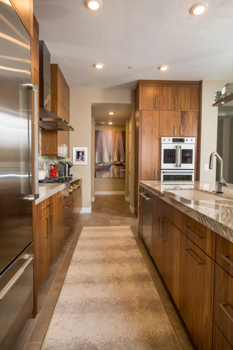 Condo Kitchen remodel with modern cabinets and stone countertops.
