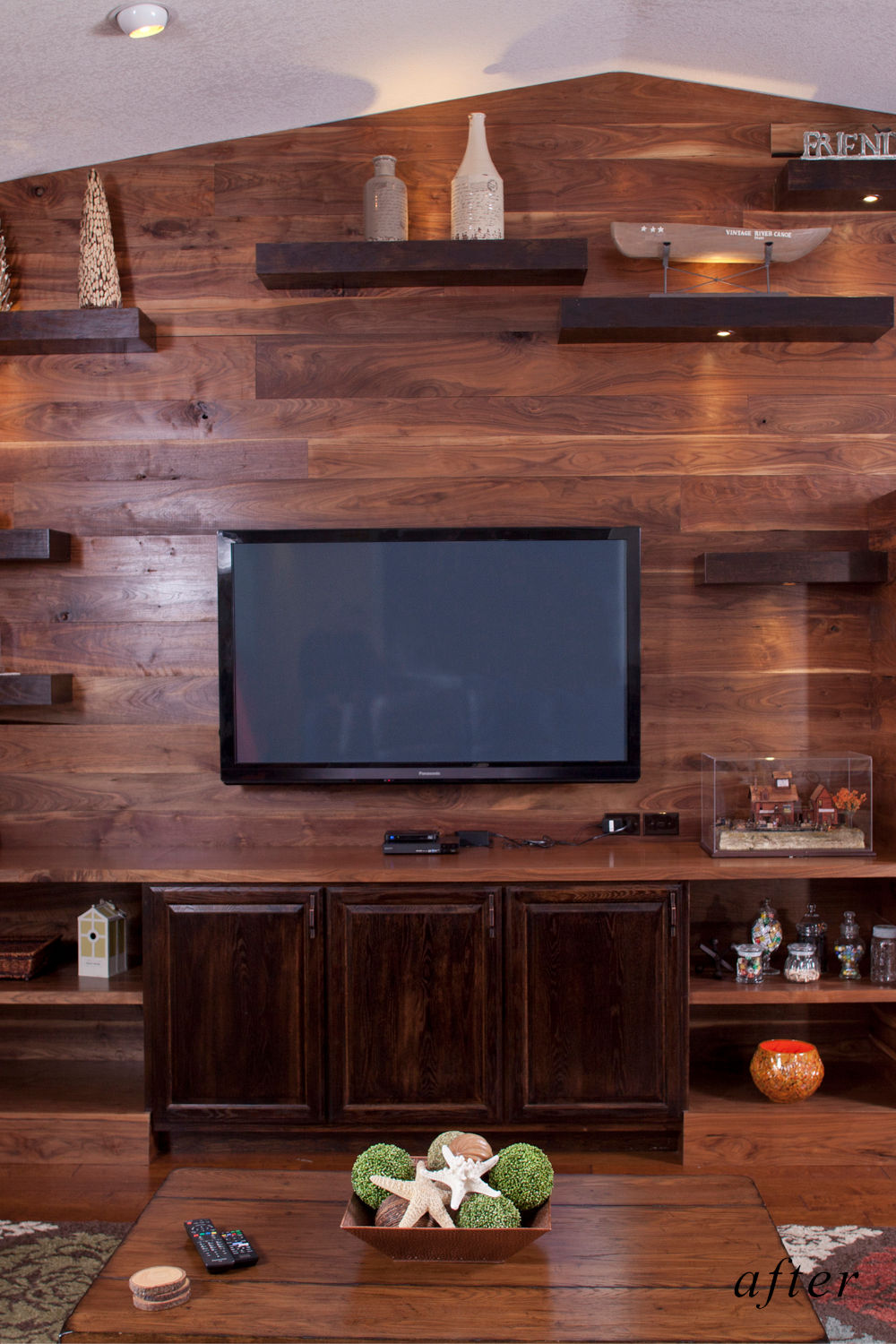 After remodel image: American walnut paneled wall as new family room entertainment center.