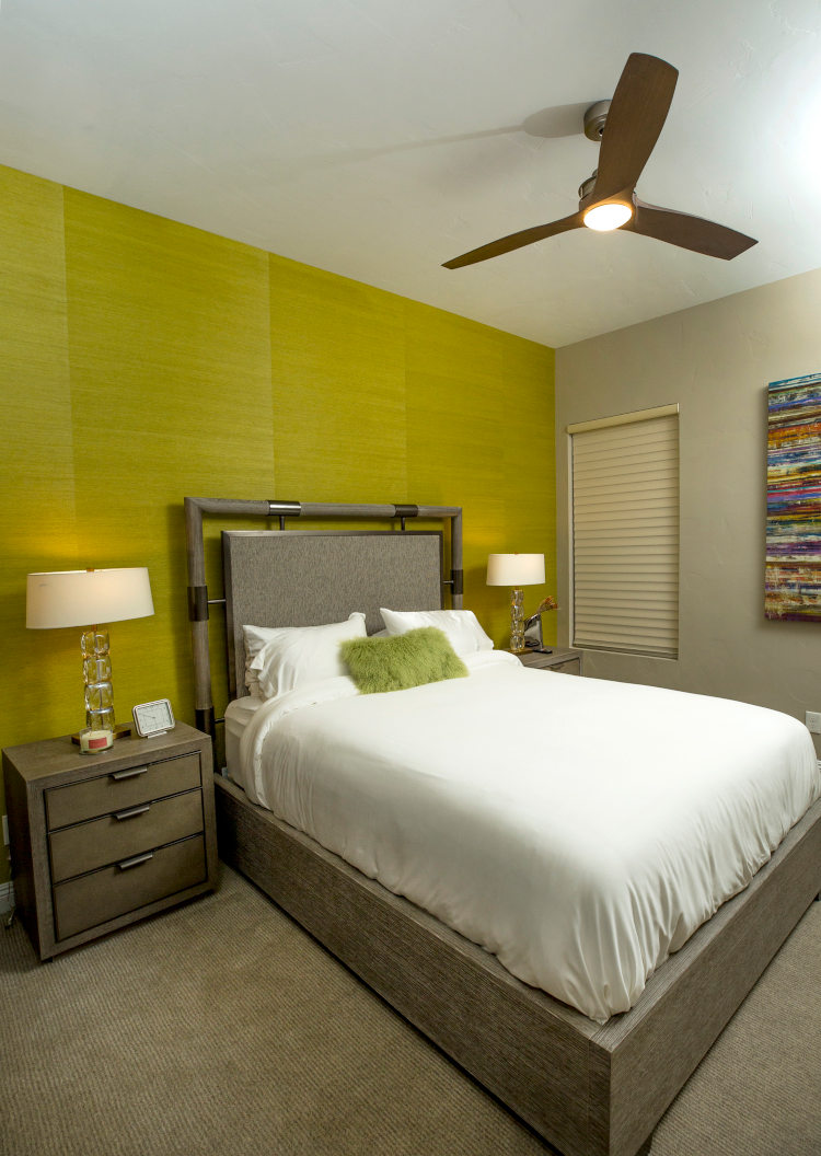 Guest bedroom with grass cloth wallpaper.