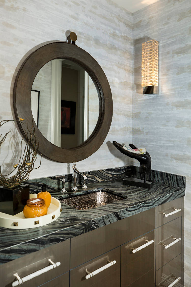 Guest bath remodel with wooden rounded mirror.