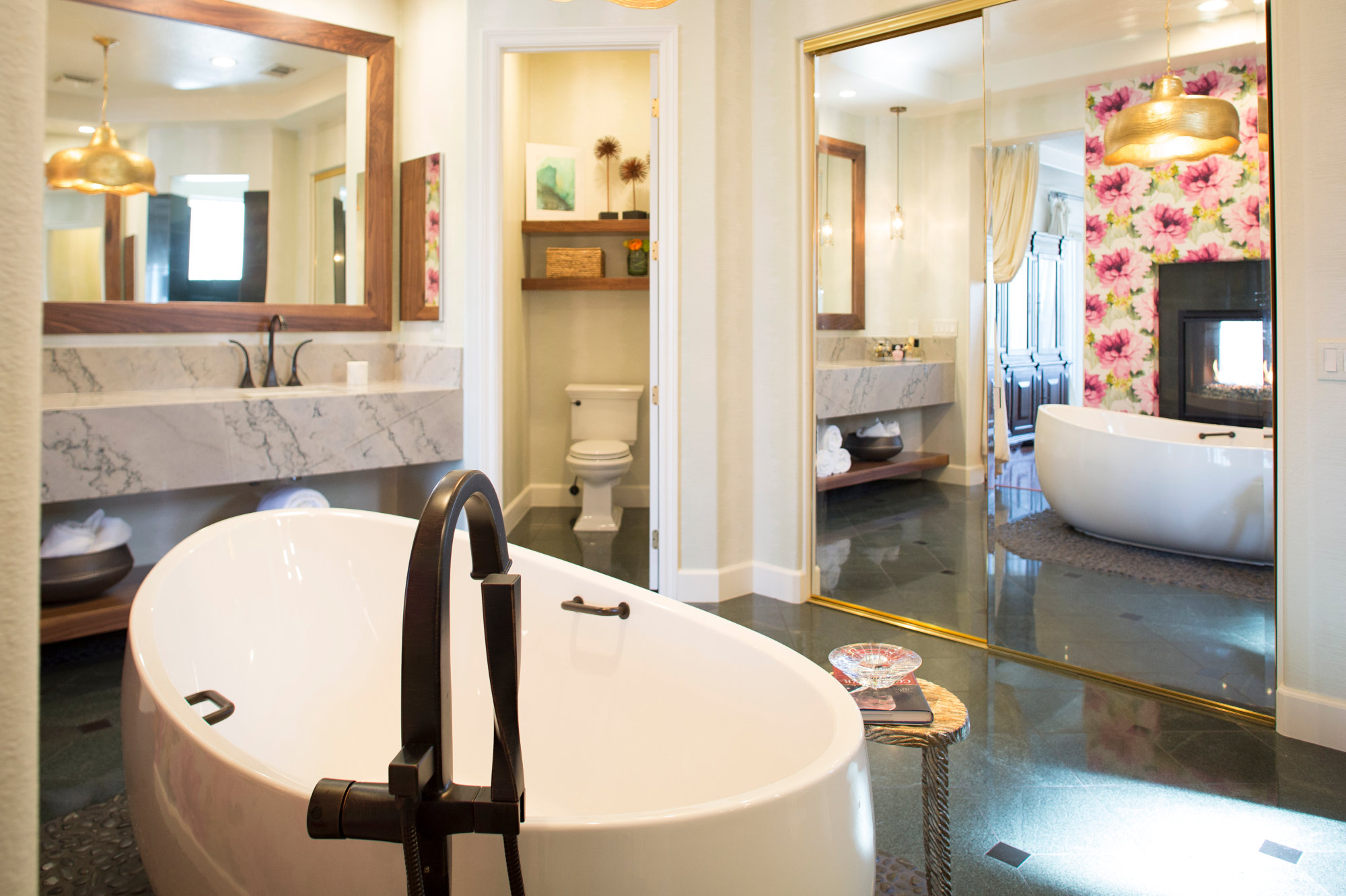 Master bathroom with free standing tub, fireplace, custom marble vanity.