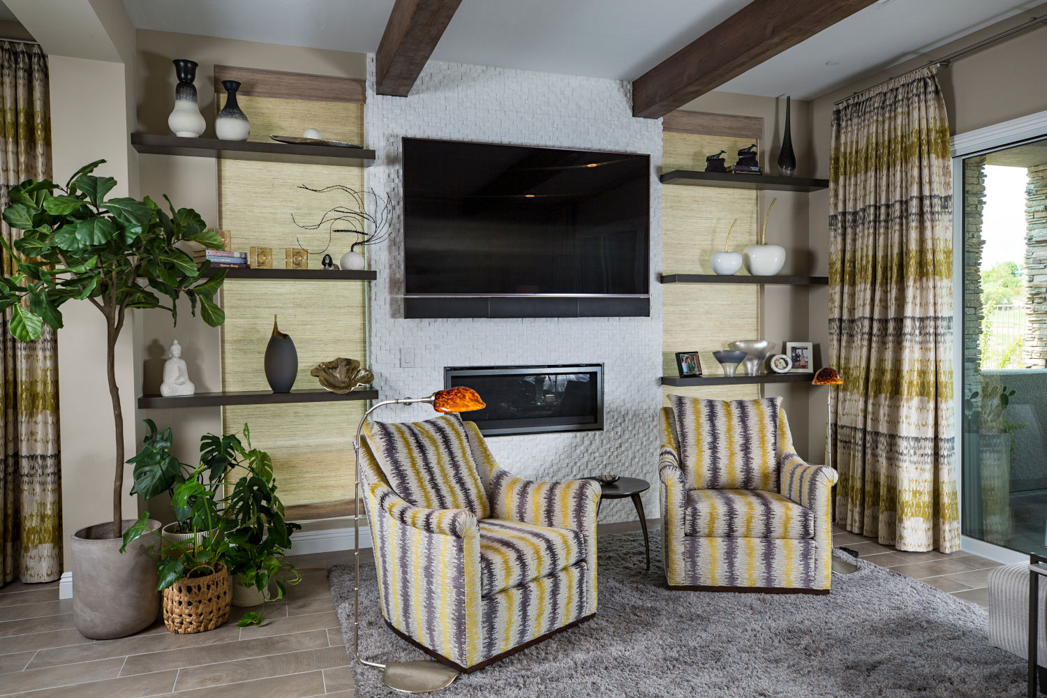 Condo remodel with yellow and black striped chairs.