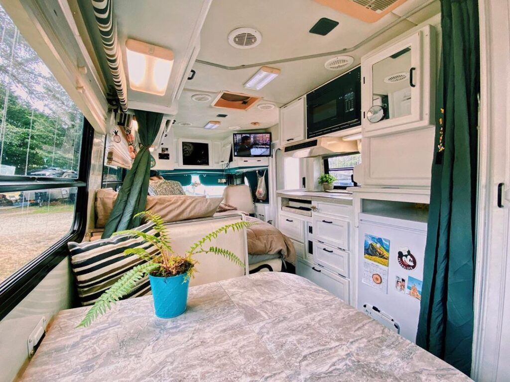 Chad and Ashley's Awesome Modified 1999 Coachman Starflyte RV the van conversion guide e-book