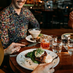 happy guests excited about their food in front of them | The Raven Room