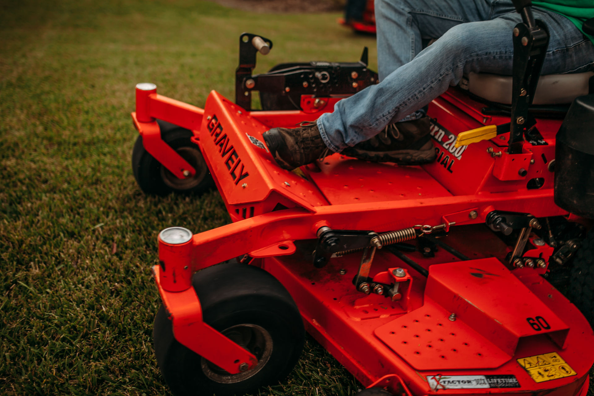 Man riding on a commercial lawn mower