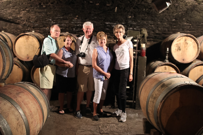 guests in cellar during wine tour visit