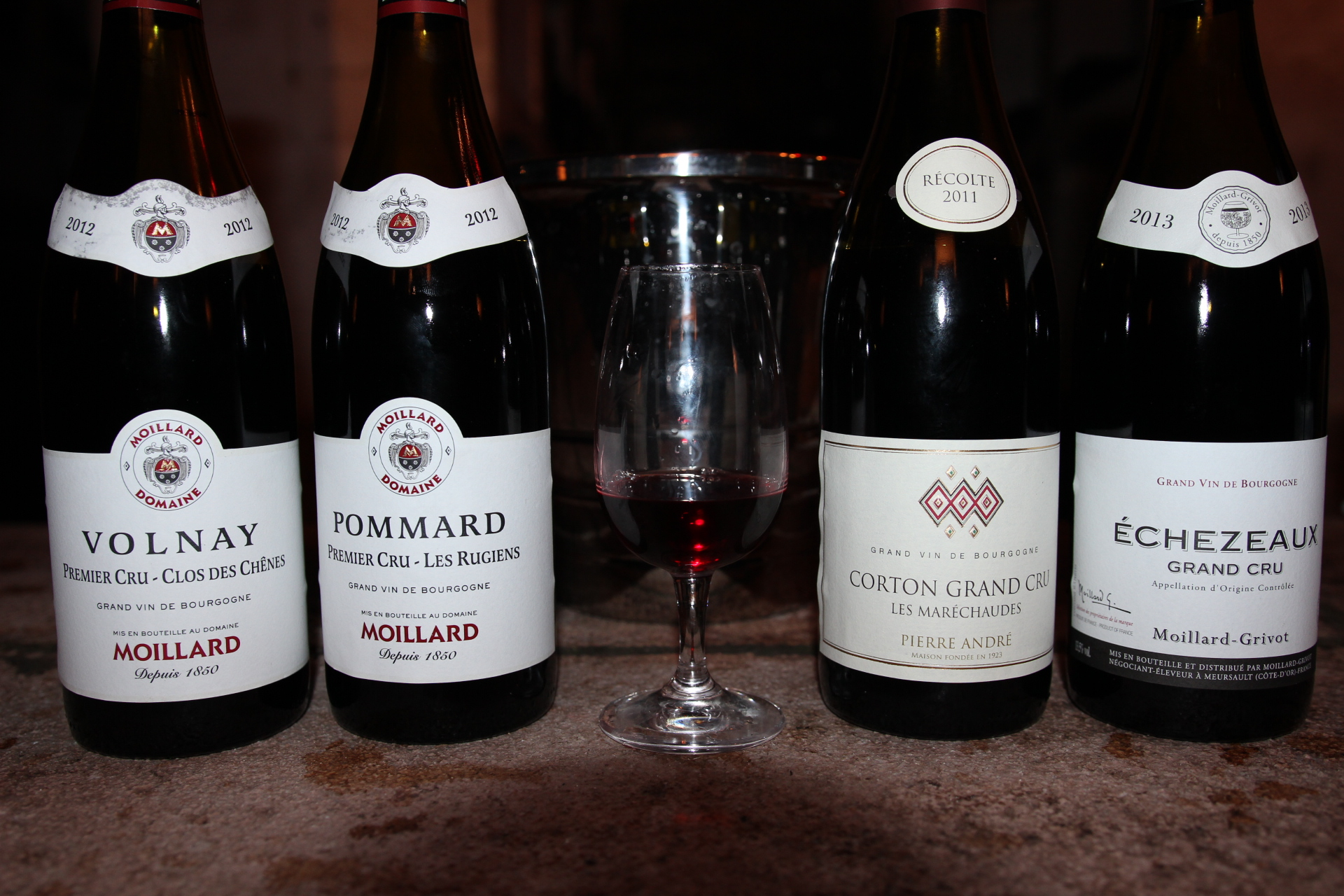 4 bottles of burgundy red wine
